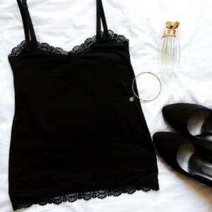 black jersey strappy tank top with lace edges bracelet and perfume