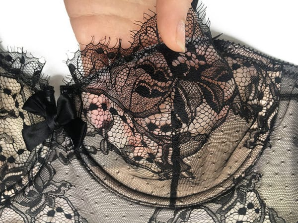 Black lace longline bra detail of the bow
