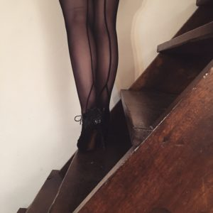 Black sheer couture stockings and high heels