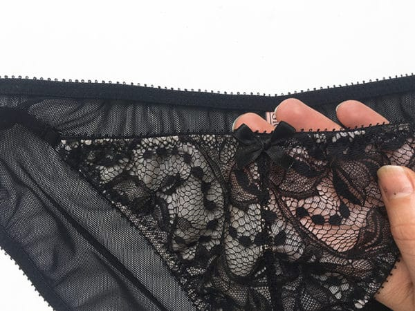 Sheer black panties bow details in mesh and lace