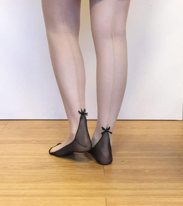 sheer stocking nude with contrasting black couture stockings
