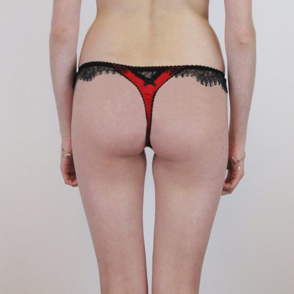silk red thong with black lace details on the back