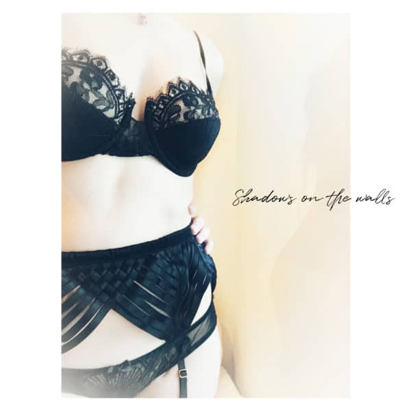 Strappy black garter-belt and lace bra